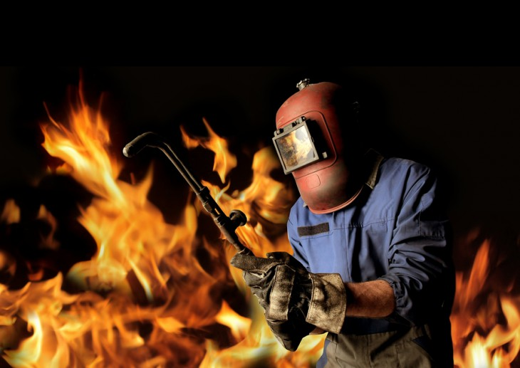 welder with flames around
