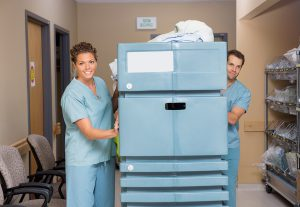 nurses deliver clean sanitized healthcare linens cart rental