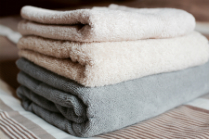 Stack of freshly laundered linens from a linen service provider
